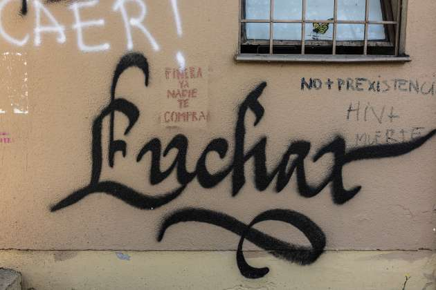 """This graffiti, meaning """"fight"""" in Spanish, is visible on a building near Plaza Italia."""