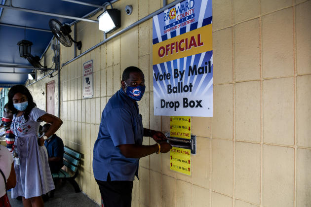 A man casts his ballot by mail at the Broward County Election Supervisor's office in Lauderhill, Fla. On October 5.  This state is one of the most crucial for the outcome of the election.