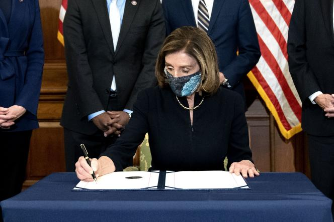 Speaker of the House of Representatives Nancy Pelosi signs the indictment of Donald Trump on January 13.