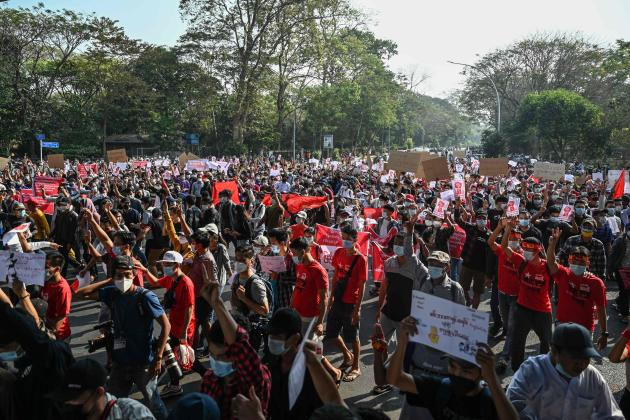 Thousands of demonstrators gather in Yangon to denounce the army's coup and demand the release of Aung San Suu Kyi on February 7.