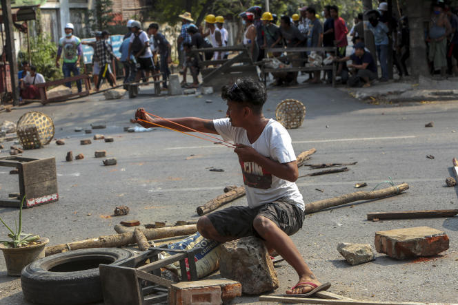 A man protesting the military coup uses a slingshot in Mandalay, Burma on Tuesday March 2.