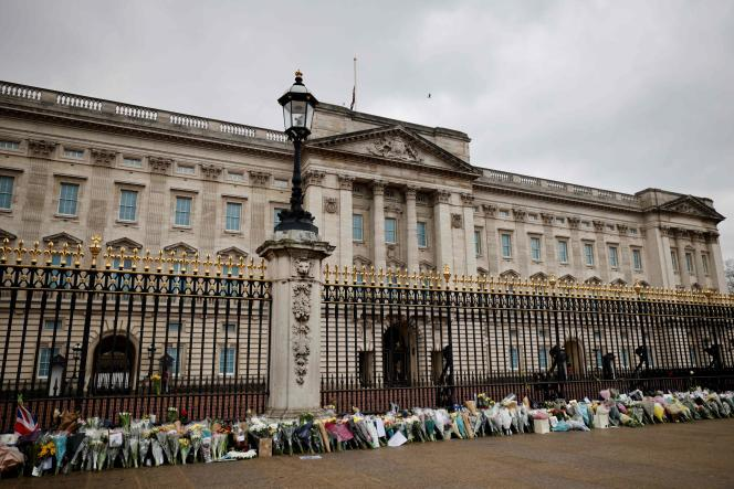 Flowers in tribute to Prince Philip, Duke of Edinburgh, are laid outside Buckingham Palace in London on April 10, 2021, the day after his death at the age of 99.