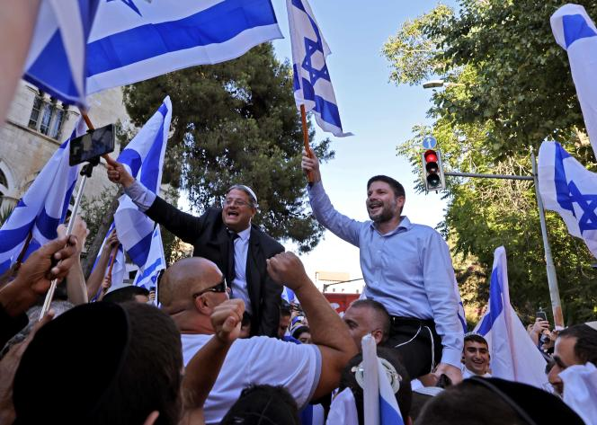 """Far-right Israeli lawmakers Bezalel Smotrich (right) and Itamar Ben-Gvir at the """"flag march"""" near the Old City of Jerusalem on June 15, 2021."""