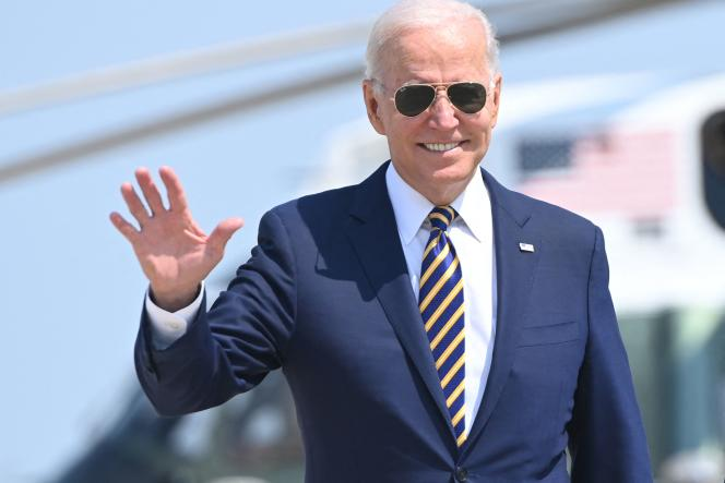 US President Joe Biden waves his hand as he walks towards Air Force One ahead of his departure from Joint Base Andrews, Md., July 28, 2021.