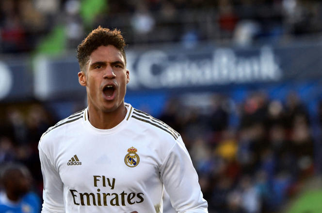 (FILES) In this file photo taken on January 04, 2020 Real Madrid's French defender Raphael Varane celebrates his goal during the Spanish league football match between Getafe CF and Real Madrid CF at the Col.  Alfonso Perez stadium in Getafe on January 4, 2020. Manchester United have agreed a deal to sign France defender Raphael Varane from Real Madrid, according to several British media reports on July 27, 2021. Varane had been a longstanding target for United, who last week completed the transfer of England winger Jadon Sancho from German club Borussia Dortmund for a reported £ 73 million ($ 100 million).  Ole Gunnar Solskjaer's men are now closing in on the signing of Real center-back Varane, having agreed a deal worth a reported £ 34million rising to £ 42million with add-ons.  (Photo by OSCAR DEL POZO / AFP)