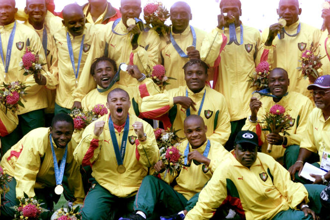 The Cameroonian Indomitable Lions celebrate their gold medal at the Sydney Olympics on September 30, 2000.