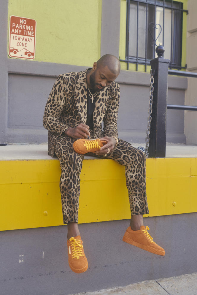 Miami Heats player PJ Tucker signs a pair of sneakers in collaboration with Dolce & Gabbana.